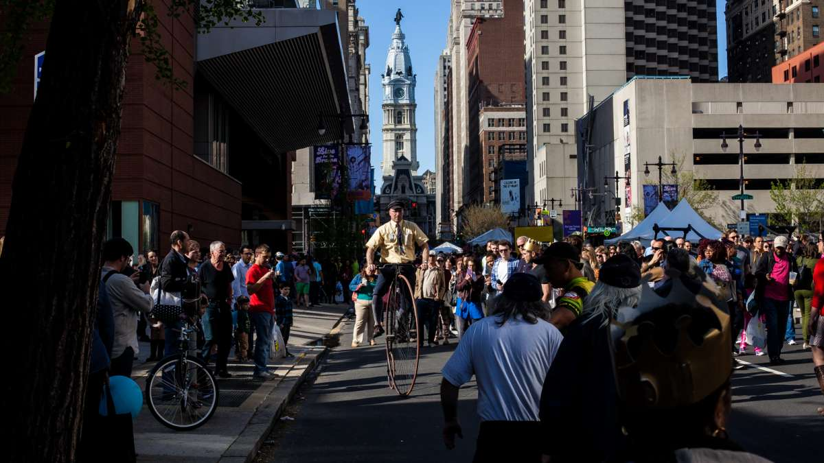 Eric Knight of The Wheelmen bicycle club rides his penny-farthing for curious spectators on South Broad Street.