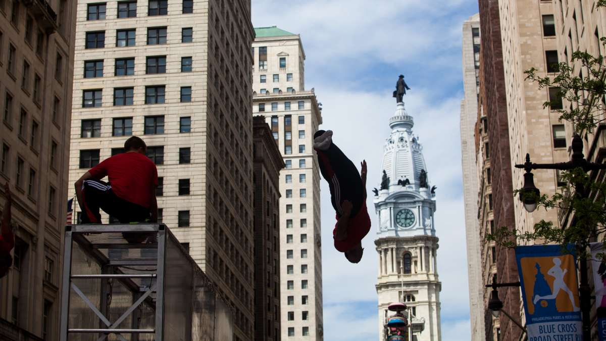 The Flippen Out trampoline/acrobat group performed at the PIFA Street Fair with City Hall as a backdrop.
