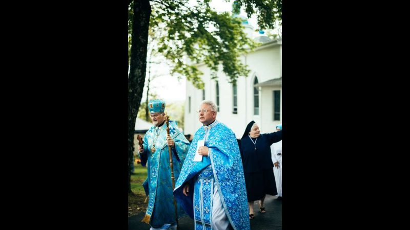 Metropolitan-Archbishop Stefan Soroka and Assumption of the Blessed Virgin Mary's pastor, Father Michael Hutsko, follow the procession of the replica of the Icon of Our Lady of Pochaiv.