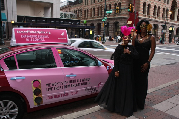 "<p><p>Breast cancer survivors Jeanette Stephens-El (left) and Jackie Greggs-Walden arrive at the Pink Tie Ball in a specially decorated ""awareness cab"" by Freedom Taxi (Photo courtesy of Dr. Kurt Bomze)</p></p>"
