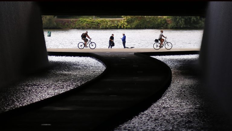 Cyclists ride along the Allegheny River in this view of a path in a tunnel under the David Lawrence Convention Center in downtown Pittsburgh. (AP Photo/Gene J. Puskar)