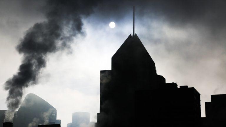 The skyline of downtown Pittsburgh is silhouetted by the rising sun on a foggy morning, December 2015. (AP Photo/Gene J. Puskar)