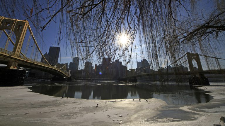 The sun hangs over the skyline of downtown Pittsburgh, beginning to melt ice on the Allegheny River. Pennsylvania cities, including Pittsburgh, ranked poorly on the Milken Institute's list of best performing metros. (AP Photo/Gene J. Puskar)