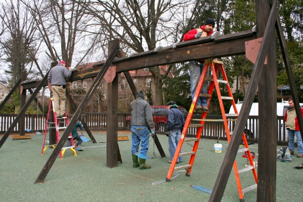 <p><p>Volunteers work replacing bolts and chains on Henry H. Houston playground's swing set. (Lane Blackmer/for NewsWorks)</p></p>