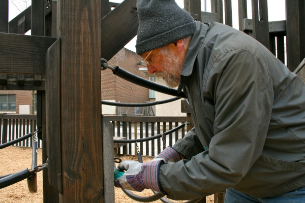 <p><p>Bob Rossman replaces a chain at Henry Houston's playground during the city's Martin Luther King Day of Service. (Lane Blackmer/for NewsWorks)</p></p>