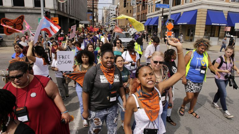 "Marchers from 40 progressive groups from 30 states take part in the ""Still We Rise"" March in downtown Pittsburgh Friday"