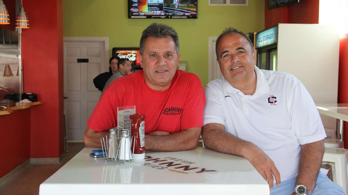 Tom Faragalli (right) and John Spadavecchia own Johnny Fries in Ortley Beach. They were able to reopen in March after repairing heavy damage from Hurricane Sandy. (Emma Lee/for NewsWorks)