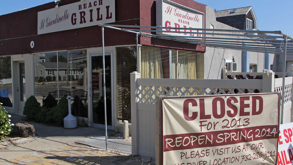 Although a sign says Il Giardinello will reopen in 2014, owners Joe and Colleen Pisacreta are not sure they will be able to restore their Normandy Beach restaurant, damaged by Hurricane Sandy. (Emma Lee/for NewsWorks)