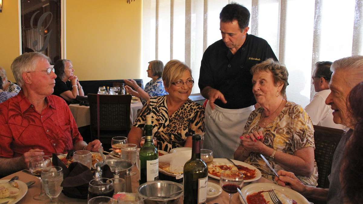 Il Giardinello Ristorante owner Joe Pisacreta mingles with customers at his Toms River restaurant. (Emma Lee/for NewsWorks)