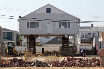 An Ortley Beach bungalow is raised to comply with building codes. (Emma Lee/WHYY)