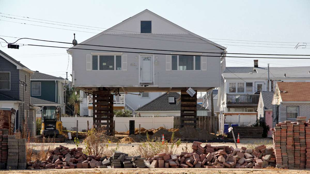 An Ortley Beach bungalow is raised to comply with new building codes. Others will have to follow suit or pay prohibitive flood insurance premiums. (Emma Lee/for NewsWorks)
