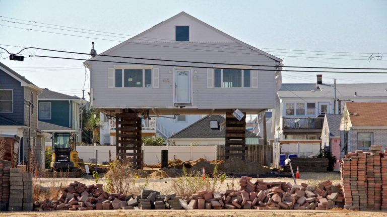 An Ortley Beach bungalow is raised to comply with new building codes. Others will have to follow suit or pay prohibitive flood insurance premiums. (Emma Lee/WHYY)