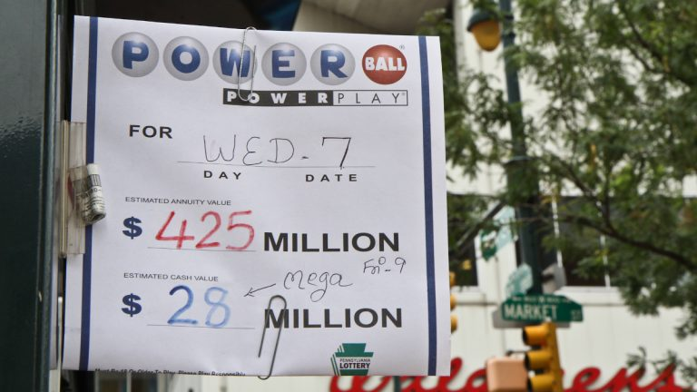 A newsstand at 9th and Market Streets sells Powerball tickets Wednesday, August 7. (Kimberly Paynter/WHYY)