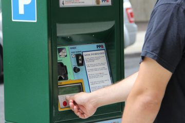 A driver uses one of the Philadelphia Parking Authority kiosks. The PPA suspended its smartphone app, MeterUp, on Wednesday, April 12, 2017. (Emma Lee/WHYY, file)