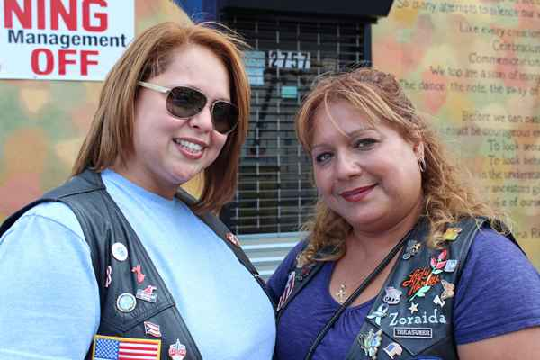 "Zoraida Figueroa (R) and Griselle Puente are active in the Hispanic American Riders Association. Their husbands have retired from the police force and their group is often called in to keep order in a ""respectful"" non- aggressive manner.  (Elisabeth Perez-Luna/WHYY)"