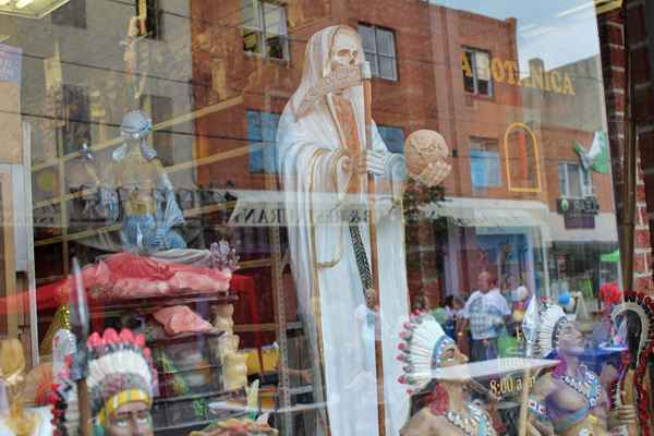 "The Philadelphia Botanica has been on 5th Street for about 45 years and labels itself as a ""place for spiritual arts.""  It sells everything ranging from potions, herbs and candles to statuettes depicting Catholic saints, African and Caribbean Orishas. (Elisabeth Perez-Luna)"