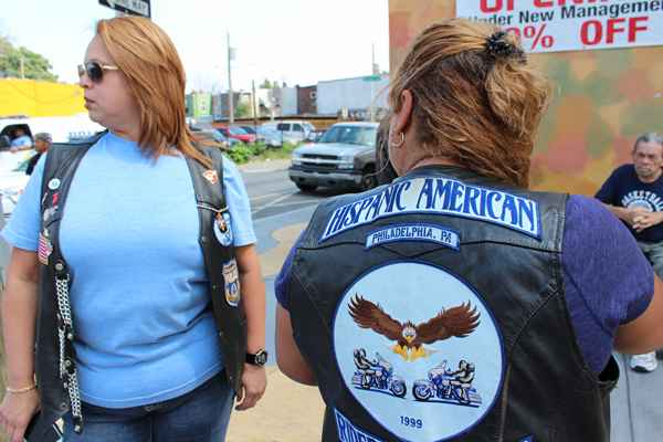 Two founding members of the Philadelphia Chapter of the Hispanic American Riders Association show their jackets.  (Elisabeth Perez-Luna/WHYY)