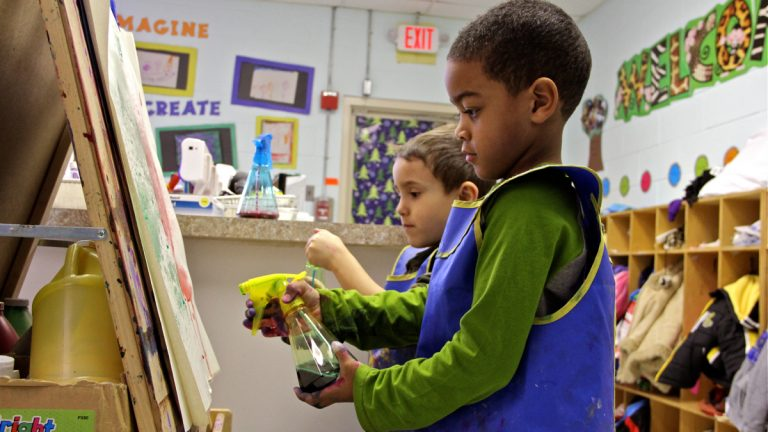 Terrell Patterson and Dominic Sampaio paint together using spray bottles at Paley Early Learning Center in Northeast Philadelphia. March 18, 2015 (Emma Lee/WHYY, file)
