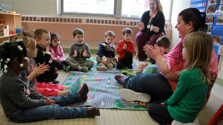 Patty Cronin (right) leads circle time for new preschoolers at SPIN-Parkwood.(Emma Lee/WHYY, file)