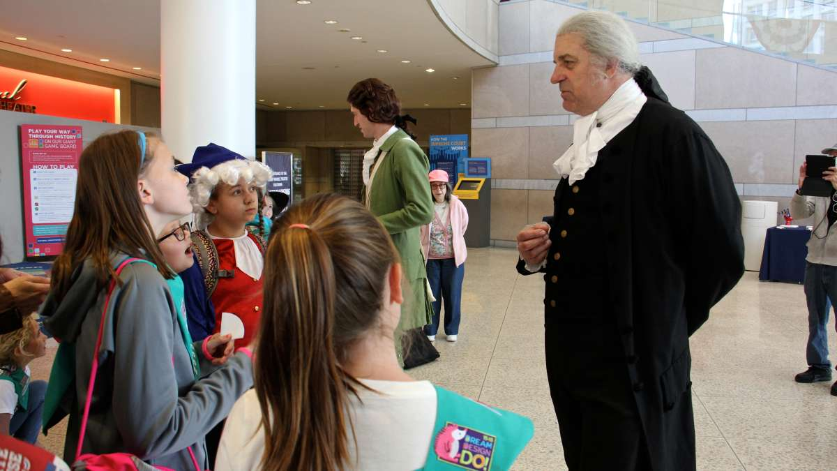 George Washington, as portrayed by John Lopes of Historic Philadelphia, addresses a group of Girl Scouts at the National Constitution Center.