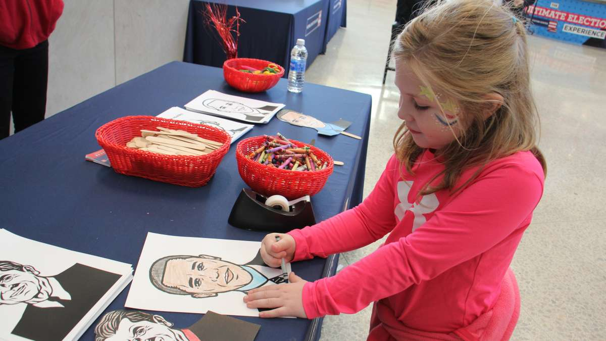 Sarah Armenia, 7, of Williamstown, New Jersey, creates a mask of her favorite president at the National Constitution Center.