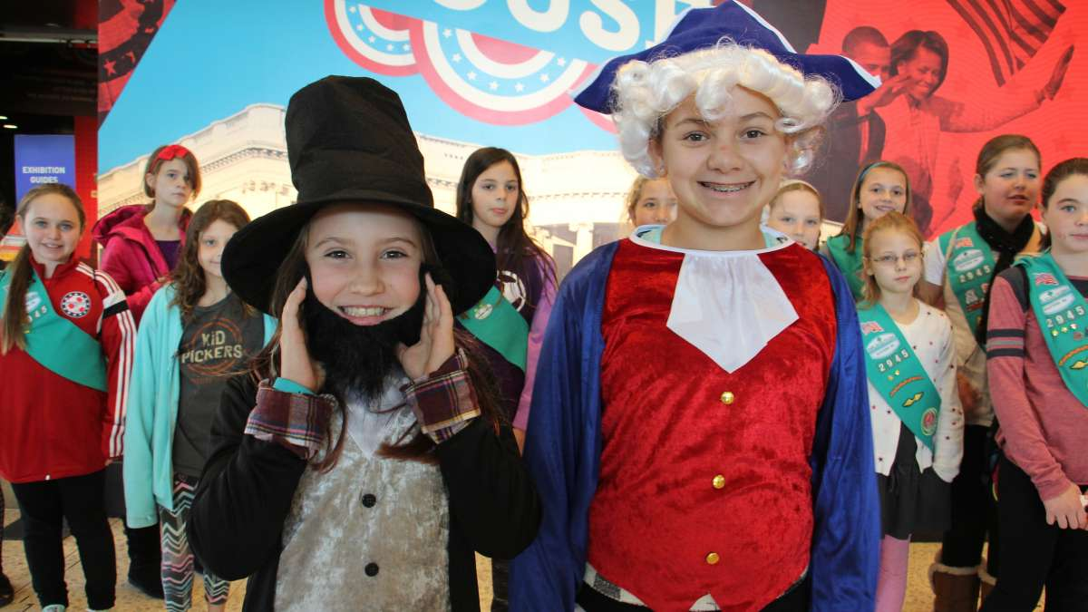 Amelia Broadway (left) and Rylee Decker of Girl Scout Troop 2945 in Newtown, Pennsylvania, portray presidents Lincoln and Washington during a trip to the National Constitution Center.