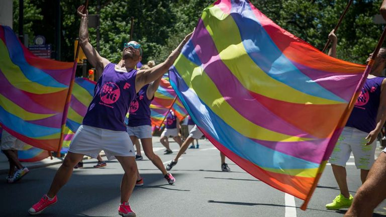 Members of the performance group 'Flaggots' dance at the Philadelphia Pride Parade and Festival. (Branden Eastwood for WHYY)