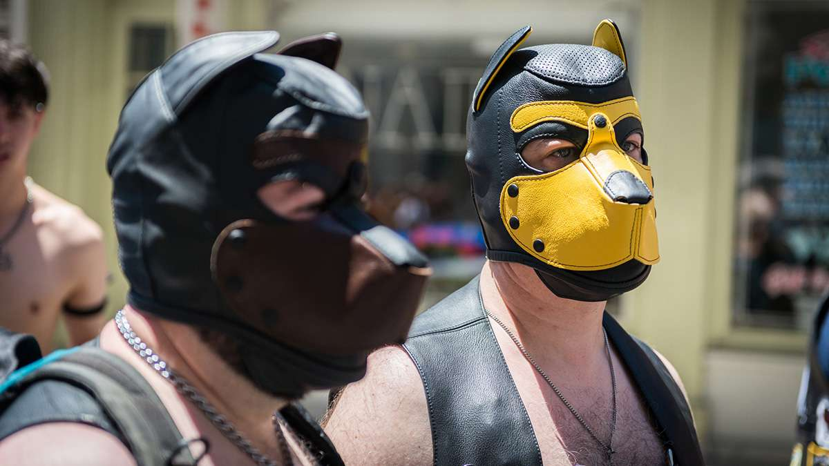Men in leather dog masks participate in the Philadelphia Pride Parade and Festival. (Branden Eastwood for NewsWorks)