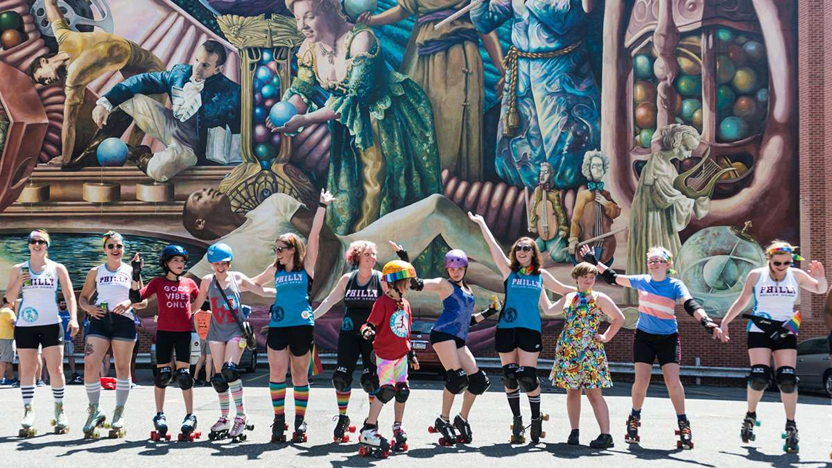 Members of Philly Roller Derby practice a dance routine at the start of Philadelphia Pride Parade and Festival. (Branden Eastwood for NewsWorks)