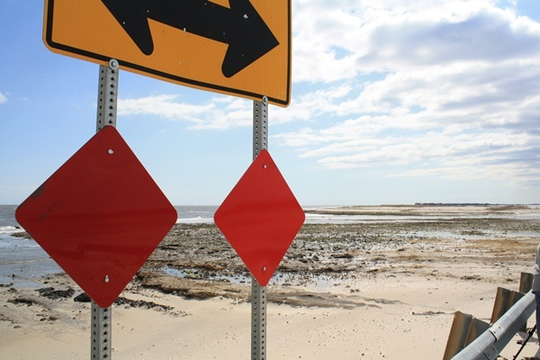 <p><p>This sign marks the end of the line at Fowler Beach.  The dune breach can be seen in the background. (Mark Eichmann/WHYY)</p></p>