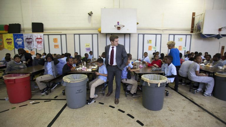 Marc Gosselin, Principal of Anna Lane Lingelbach Elementary School in Philadelphia with students during lunch. (Photograph by Jessica Kourkounis)