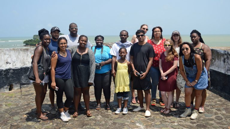 Lehigh University's Ghana Study Abroad group in the summer of 2016 includes Professor James Peterson (fourth from left) and Professor Kwame Essien (center). This photo was taken at Cape Coast Slave Castle. (Miles Davis)