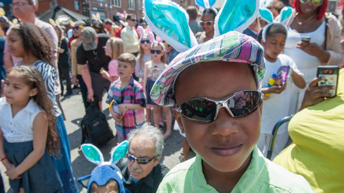Edward Coleman poses in his Easter attire while sporting a pair of rabbit ears.