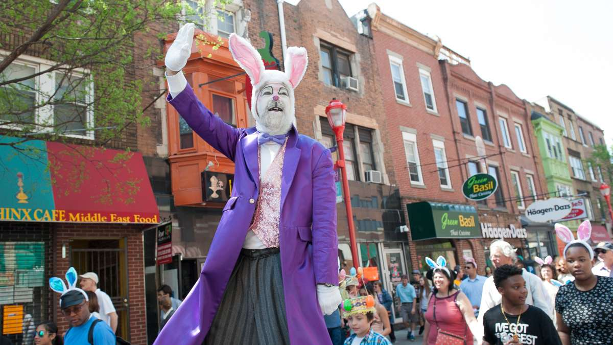 On stilts, Dale Varga waves to the crowd that lined South Street for the annual Easter Promenade in South Philadelphia.