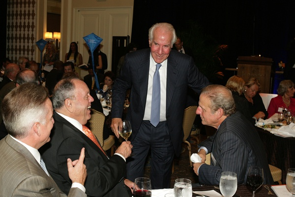 <p><p>Honorary event chair and chair of Comcast-Spectacor Ed Snider (standing), talks with guests including Fred Shabel, vice chair of Comcast-Spectacor (left), and Ron Caplan of Philadelphia Management Corp. (Photo courtesy of Deborah Boardman)</p></p>