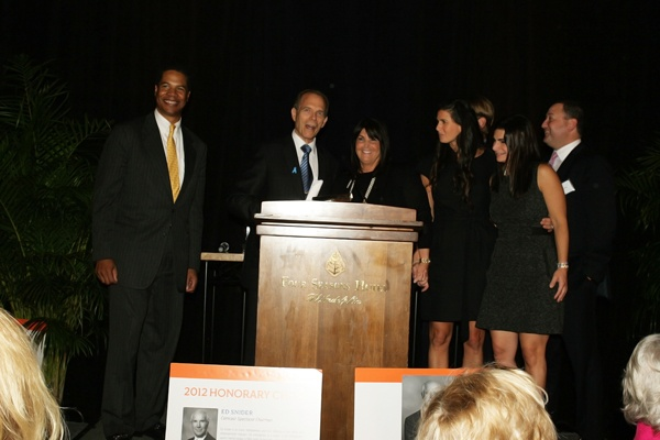 <p><p>Event emcee Joe Watkins (left) and founding event cochair Neal Rodin of International Financial Co., with the family of the late Warren Weiner during a tribute to Weiner (Photo courtesy of Deborah Boardman)</p></p>