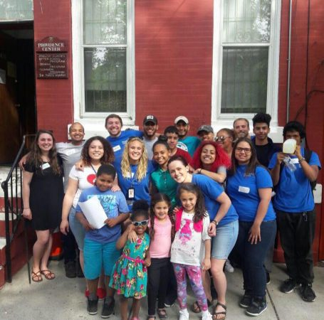 Savannah (middle row, 2nd to the left) poses with the staff of The Providence Center outside their North Philly headquarters. (Photo courtesy of The Providence Center)