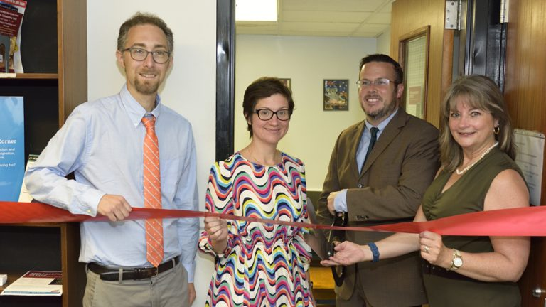 (From left) Regional Librarian Peter Lehu; Customer Service Manager Bridget Bielicki;State Representative Kevin J. Boyle; and Siobhan A. Reardon, President and Director of the Free Library of Philadelphia pose for a photo during the ribbon cutting ceremony of a new passport center in Northeast Philadelphia. (Photo by Jules Vuotto)