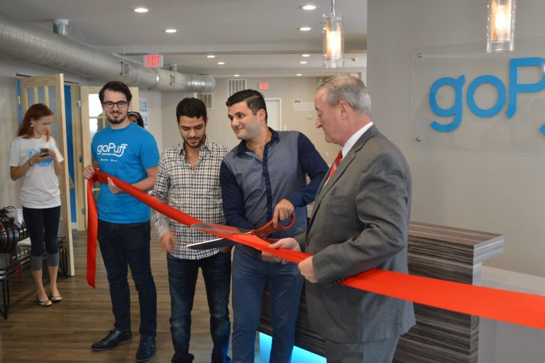 Mayor Jim Kenney helps with ribbon cutting at Go Puff Headquarters (Tom MacDonald/WHYY)