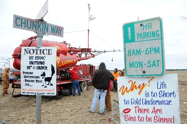 <p><p>The Emancipator team sets up at the intersection of Punkin Lane and Chunkin Way. (Chuck Snyder/for NewsWorks)</p></p>
