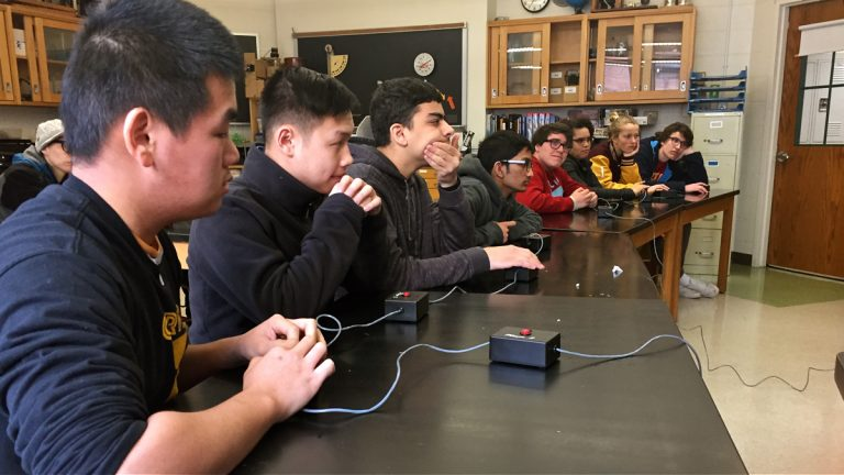 From left to right, William Zhang, Su Ly, Hasan Taloui, and Mohammed Imon of the Carver HS Quizbowl team play against Central HS at the city's Quizbowl championship. (Avi Wolfman-Arent/WHYY)