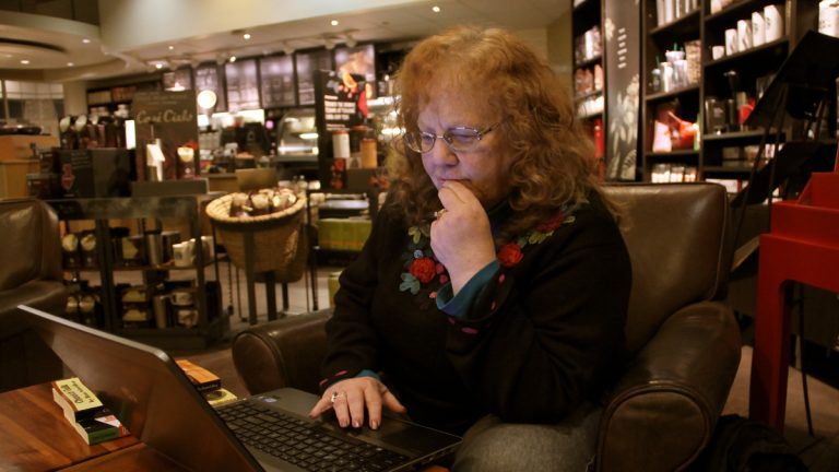 Ilene Schneider likes to work at a Starbucks near her home. (Emma Lee/WHYY)