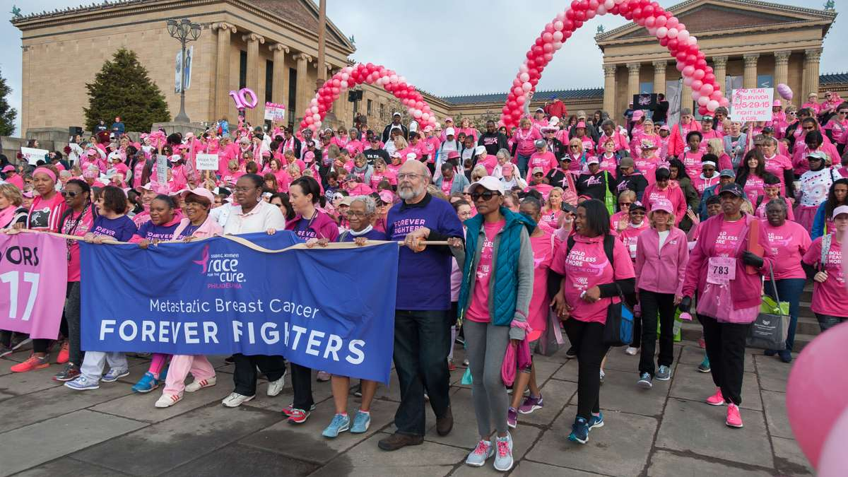 Participants in the Survivors Parade of Pink and the Salute to Forever Fighters walk down the steps of the Philadelphia Museum of Art.