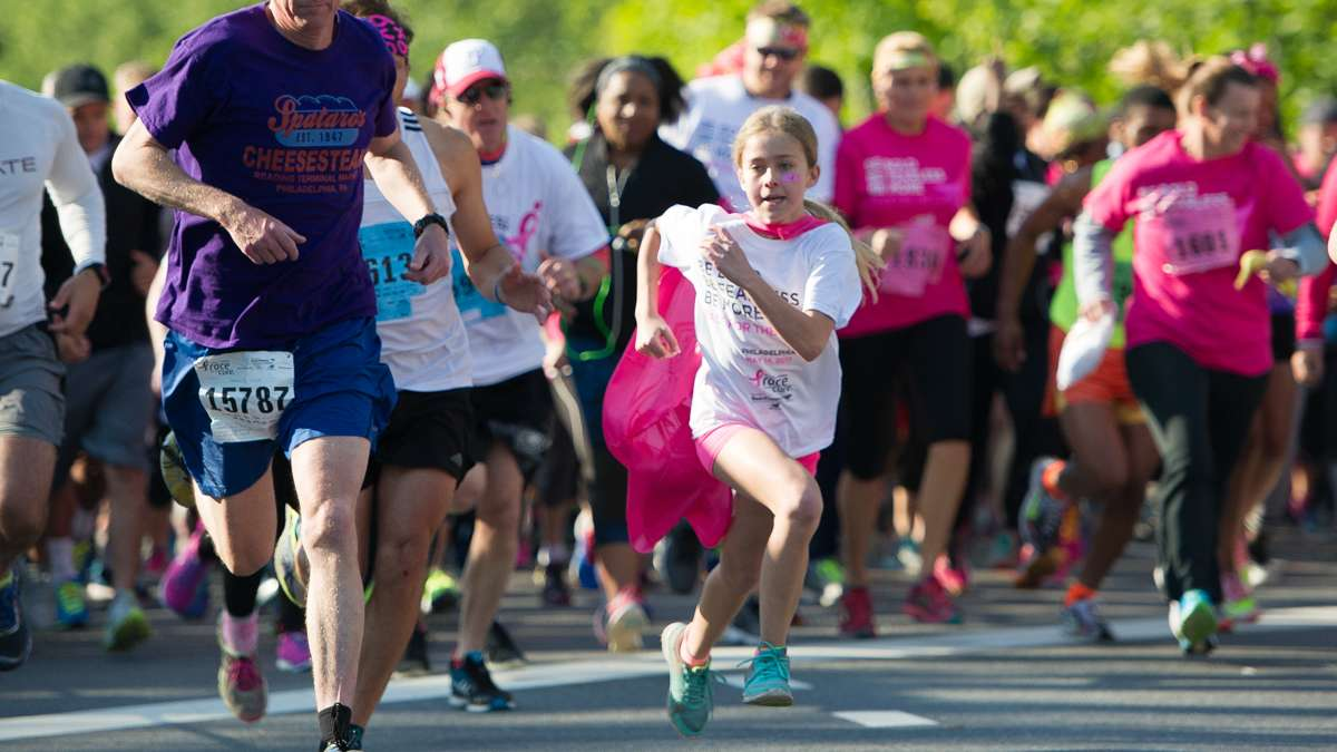Runners take off from the starting line at the 5K race during the Race for the Cure.