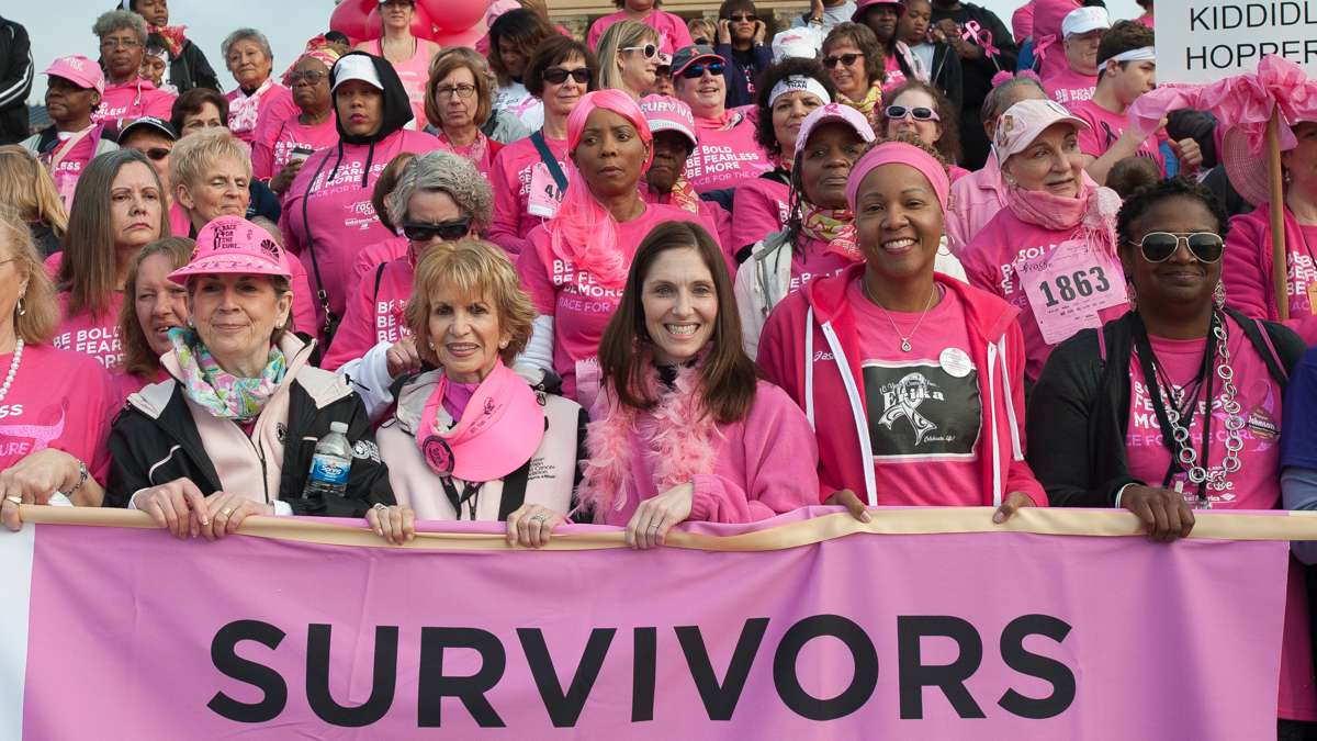 Breast cancer survivors stand at the top of the steps of the Philadelphia Museum of Art.