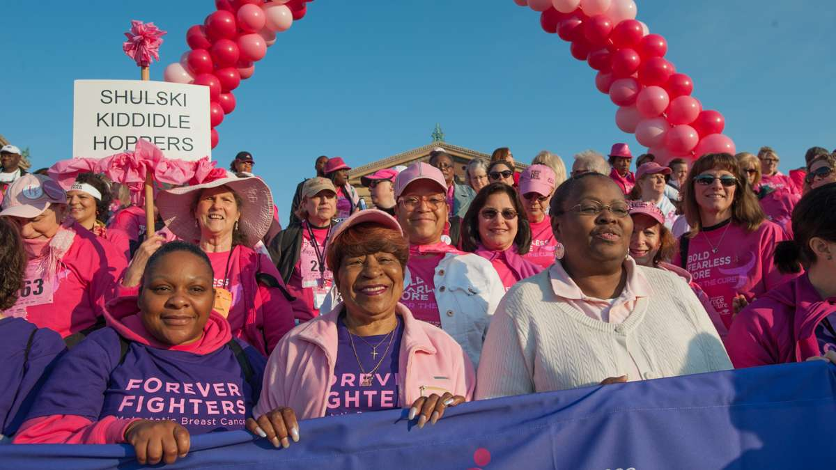 Participants in the Survivors Parade of Pink and Salute to Forever Fighters prepare to walk down the steps of the Philadelphia Museum of Art.