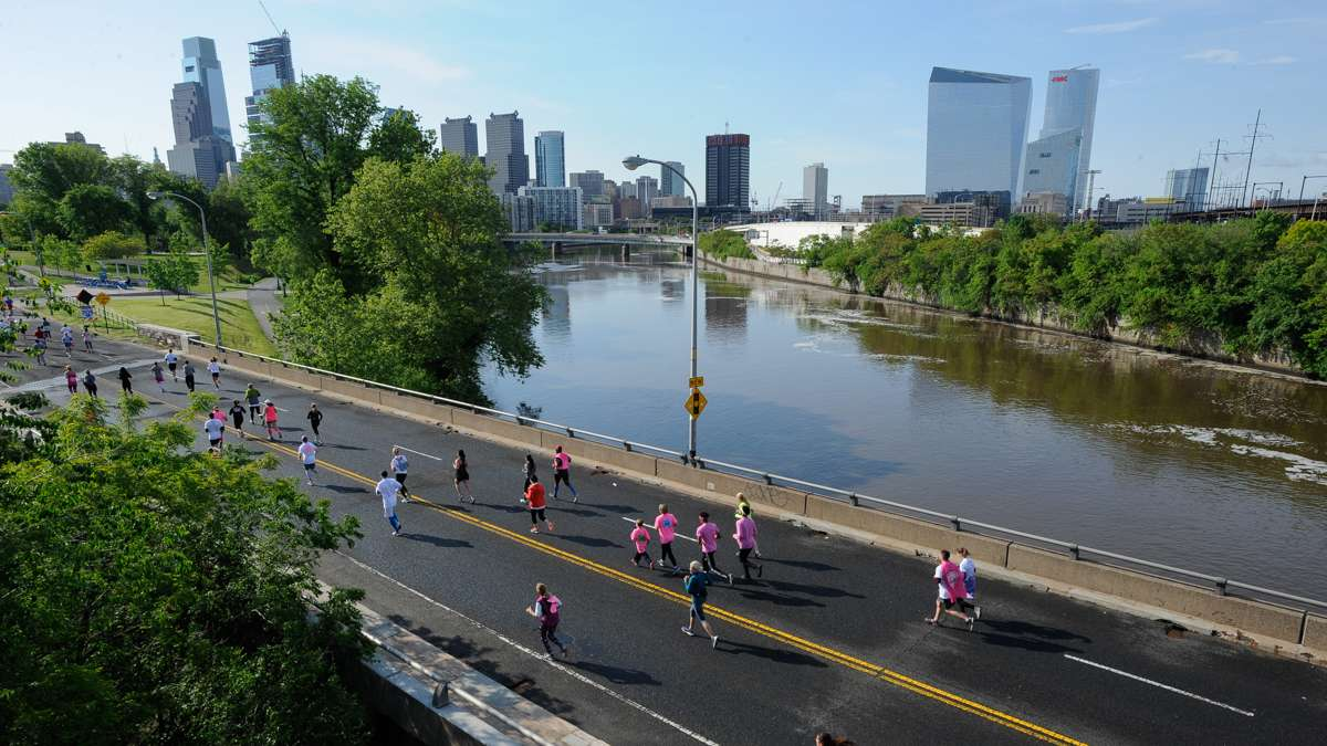 Runners cross the Schuylkill River during the last leg of the 5K race.