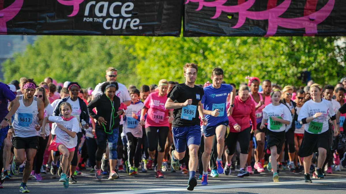 Runners in the 5K Race for the Cure take off from the starting line.