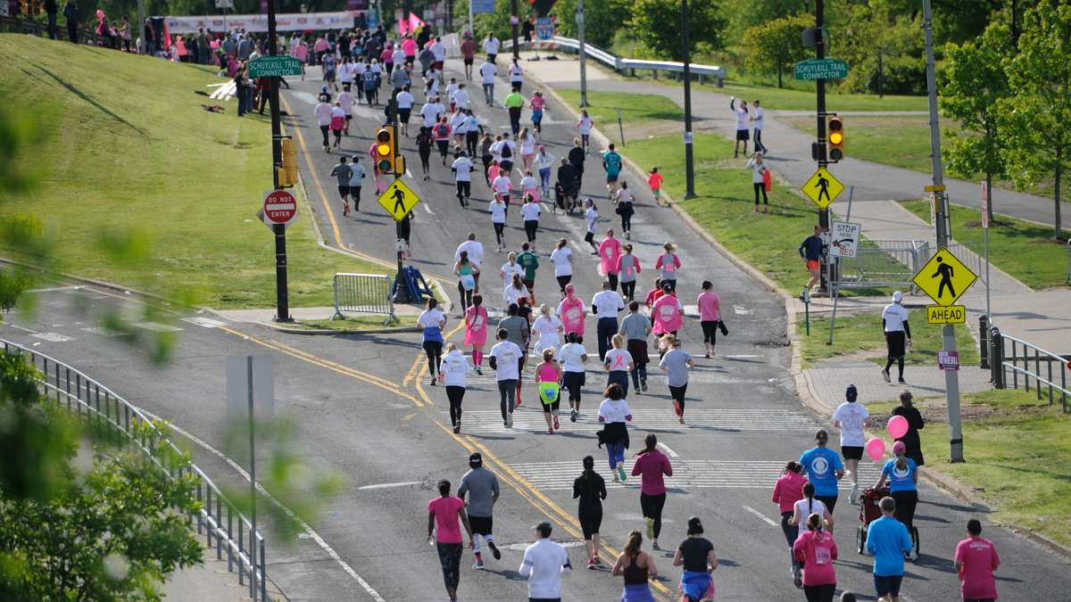 Runners head for the finish line of the 5K event during the Race for the Cure.