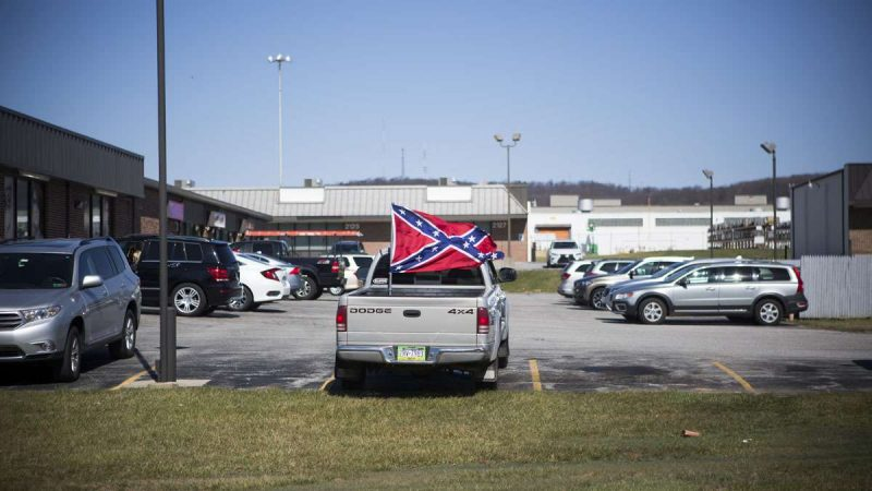 A Confederate flag is prominently displayed in a truck bed parked in a strip mall in York, Pennsylvania. (Jessica Kourkounis/For Keystone Crossroads)